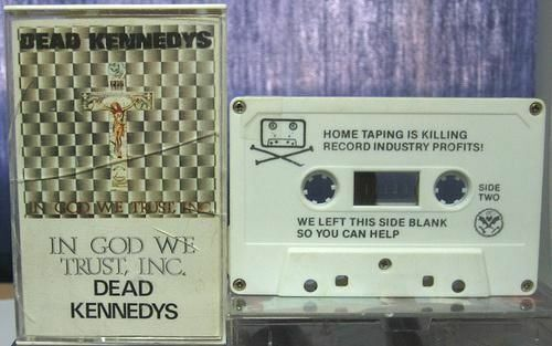 Music cassette tape. Cover: Dead Kennedys, In God We Trust, Inc; Cassette side two: Home taping is killing record industry profits! We left this side blank so you can help