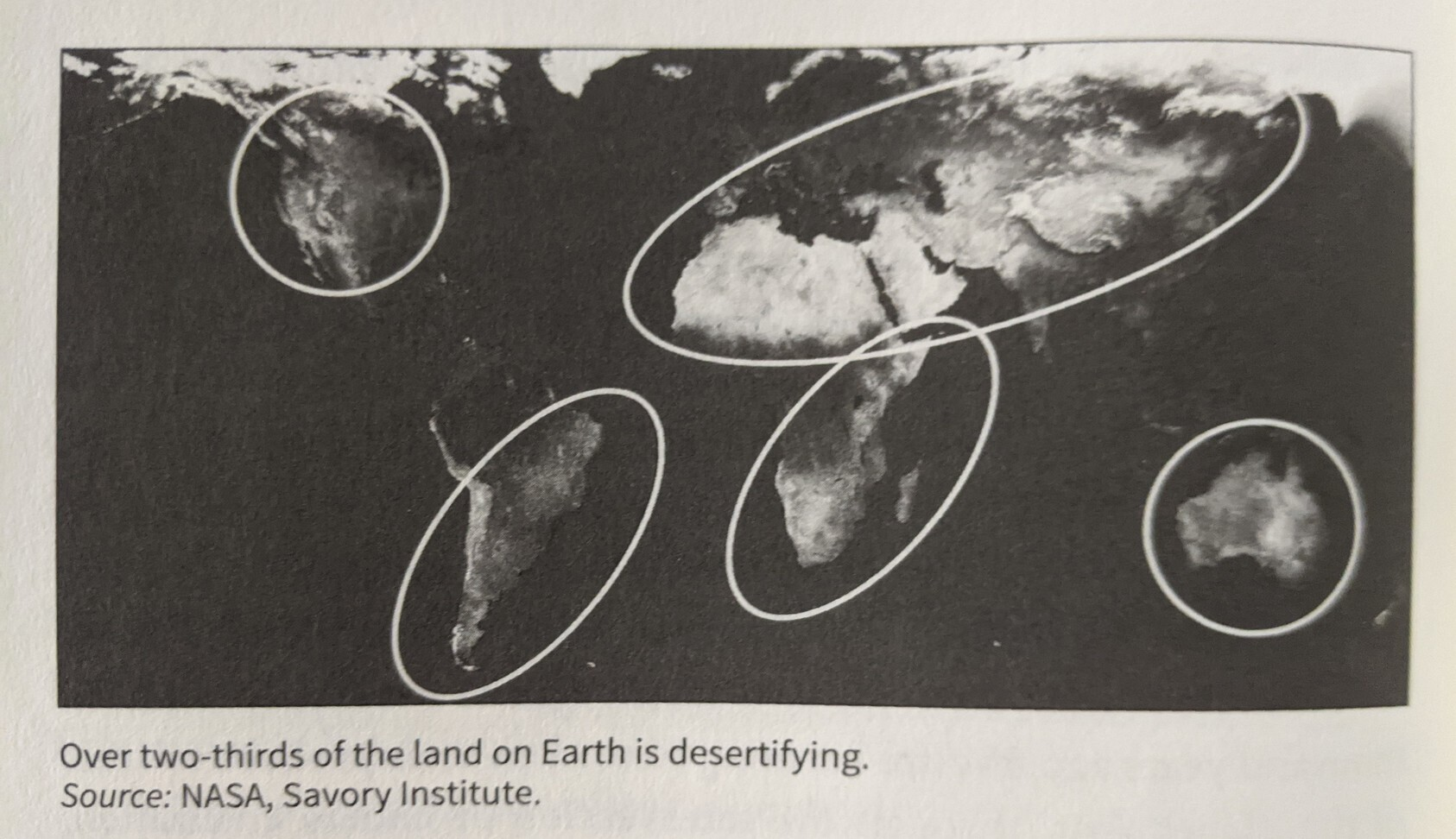 Global map circling places on continents where the Earth is desertifying.