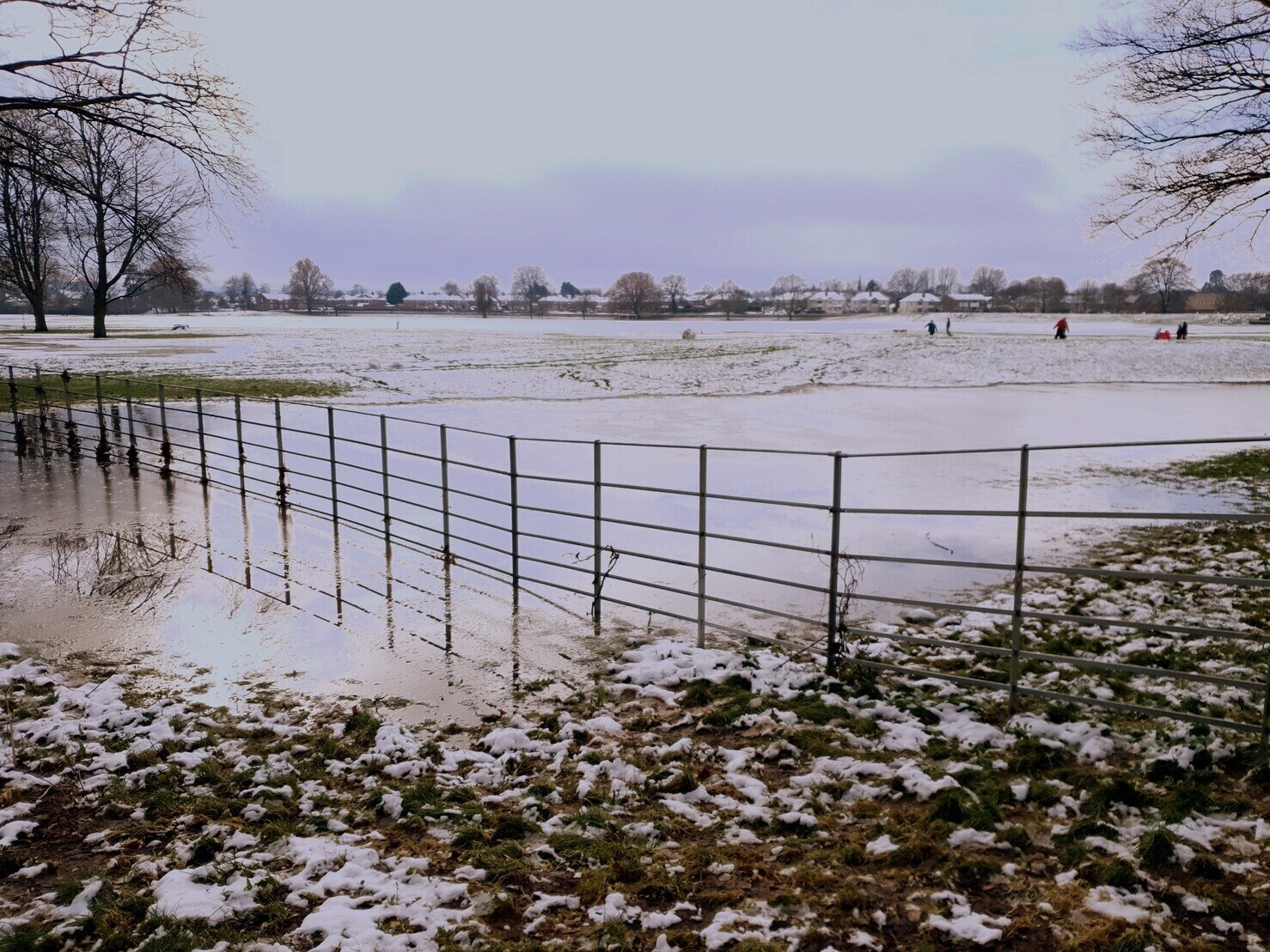 Fence in frozen floodwater at Bishops Meadow Hereford